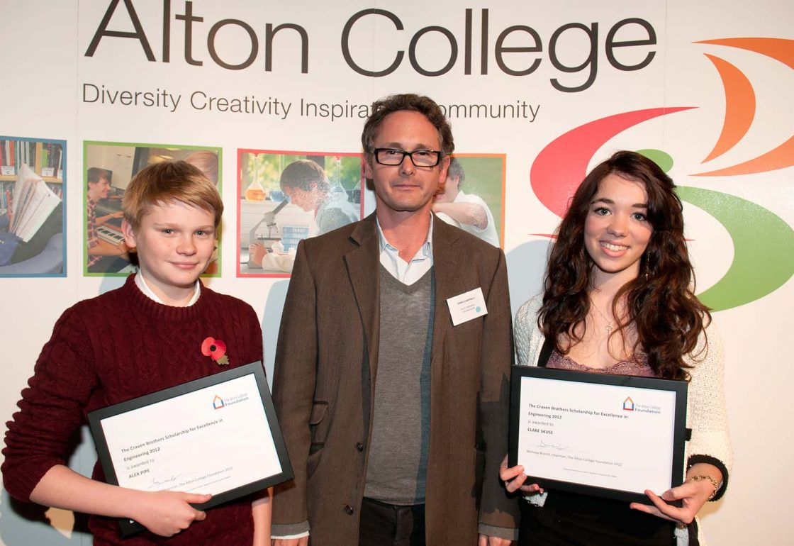 An image of Jamie Campbell presenting two scholars from Alton College with the Craven Brothers Scholarships Alex Pipe and Clara Skuse - An Ellis Campbell Foundation charitable grant in Hampshire