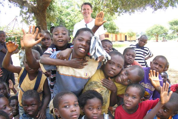 An image of Jamie Campbell and a group of young people at Makangwe Community School, a build It International project supported by the Ellis Campbell Foundation, helping disadvantaged young people in Hampshire, London and Perthshire