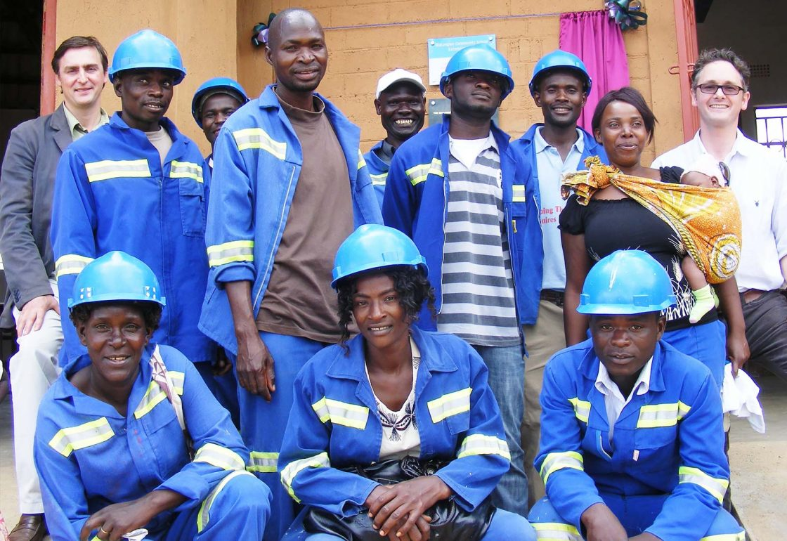 An image of Jamie Campbell and a group of construction workers at Makangwe Community School, a build It International project supported by the Ellis Campbell Foundation, helping disadvantaged young people in Hampshire, London and Perthshire