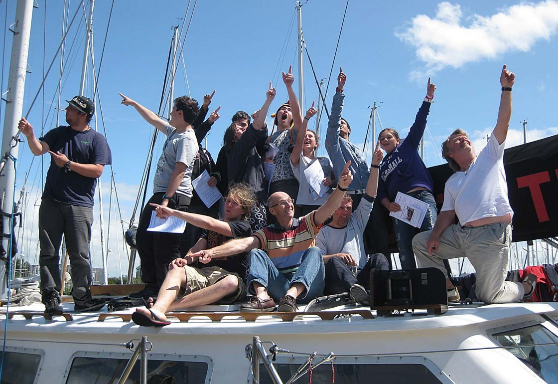 An image of a group of young people sat on the roof of a boat part of Ocean Youth Trust South a charity supported by the Ellis Campbell Foundation, helping disadvantaged young people in Hampshire, London and Perthshire