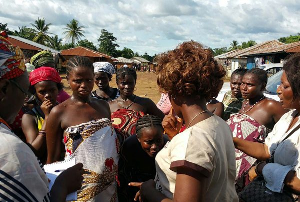 An image of African women in a rural community in Sierra Leone partaking in a sensitisation campaign, a cause supported by the Ellis Campbell Foundation, helping disadvantaged young people in Hampshire, London and Perthshire