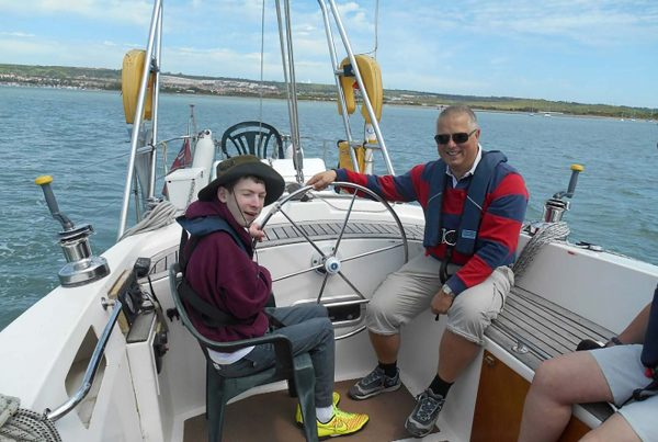 An image of Ben sailing a yacht the Treloar Trust Campbell Sports fund, a charity supported by the Ellis Campbell Foundation, helping disadvantaged young people in Hampshire, London and Perthshire