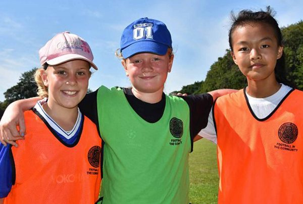 An image of three young children representing Football in the Community an Ellis campbell Foundation grant helping disadvantaged young people in Hampshire, London and Perthshire