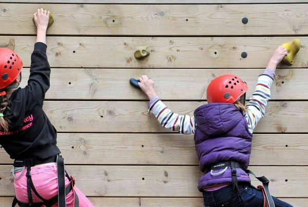 A photo of two young girls using a climbing wall for UK Youth - An Ellis Campbell Foundation charitable grant
