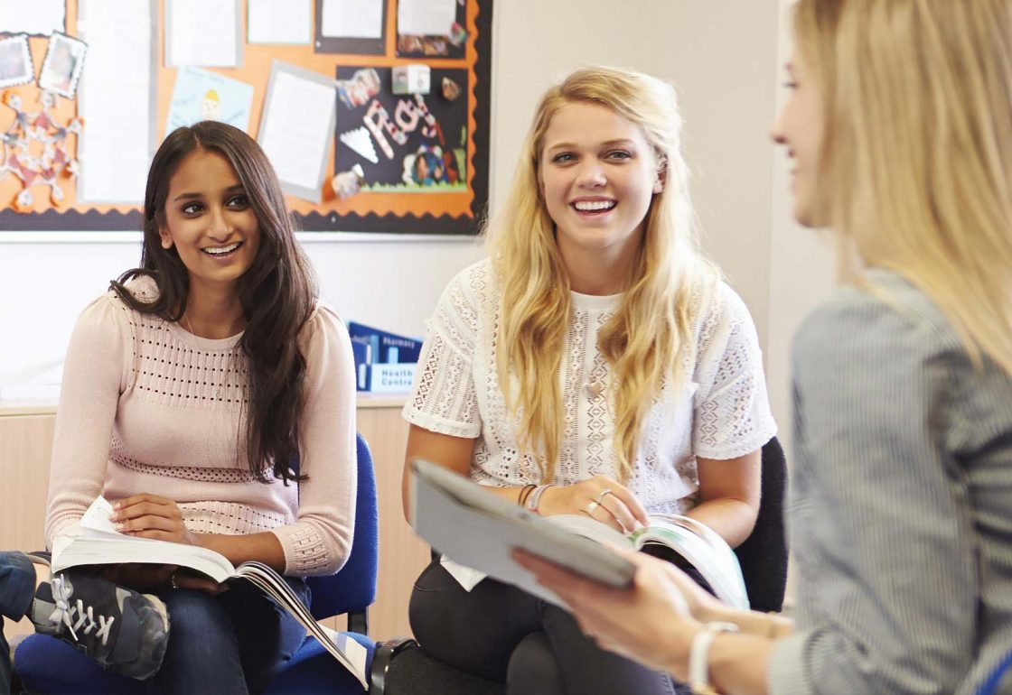A photo of young women chatting and smiling as part of UK Youth Informal Education Programme - An Ellis Campbell Foundation charitable grant donation