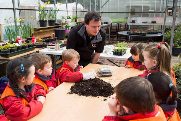 An image of a group of young children sat around a table learning about soil representing Young Enterprise Scotland a grant by the Ellis Campbell Foundation helping disadvantaged young people in Hampshire, London and Perthshire