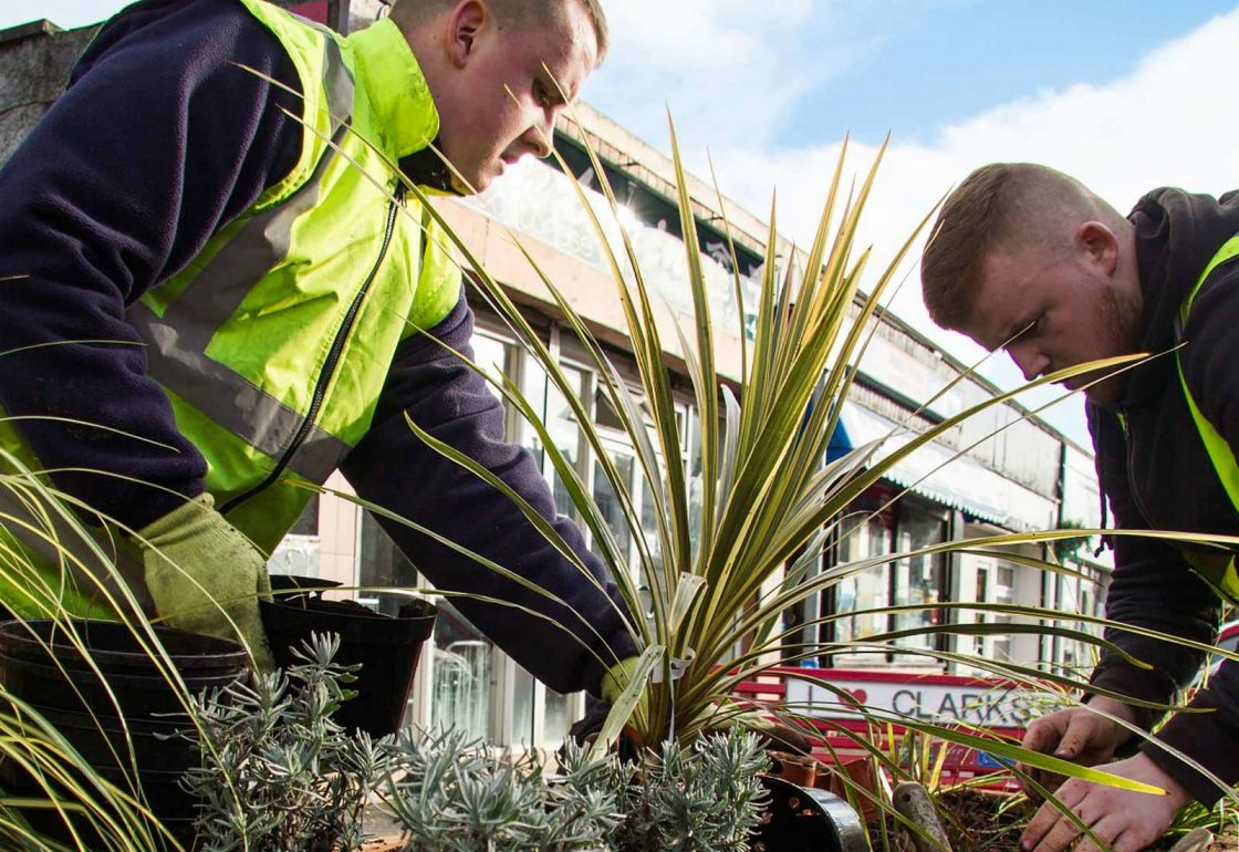 An image of two men helping with a gardening project representing Young Enterprise Scotland a grant by the Ellis Campbell Foundation helping disadvantaged young people in Hampshire, London and Perthshire