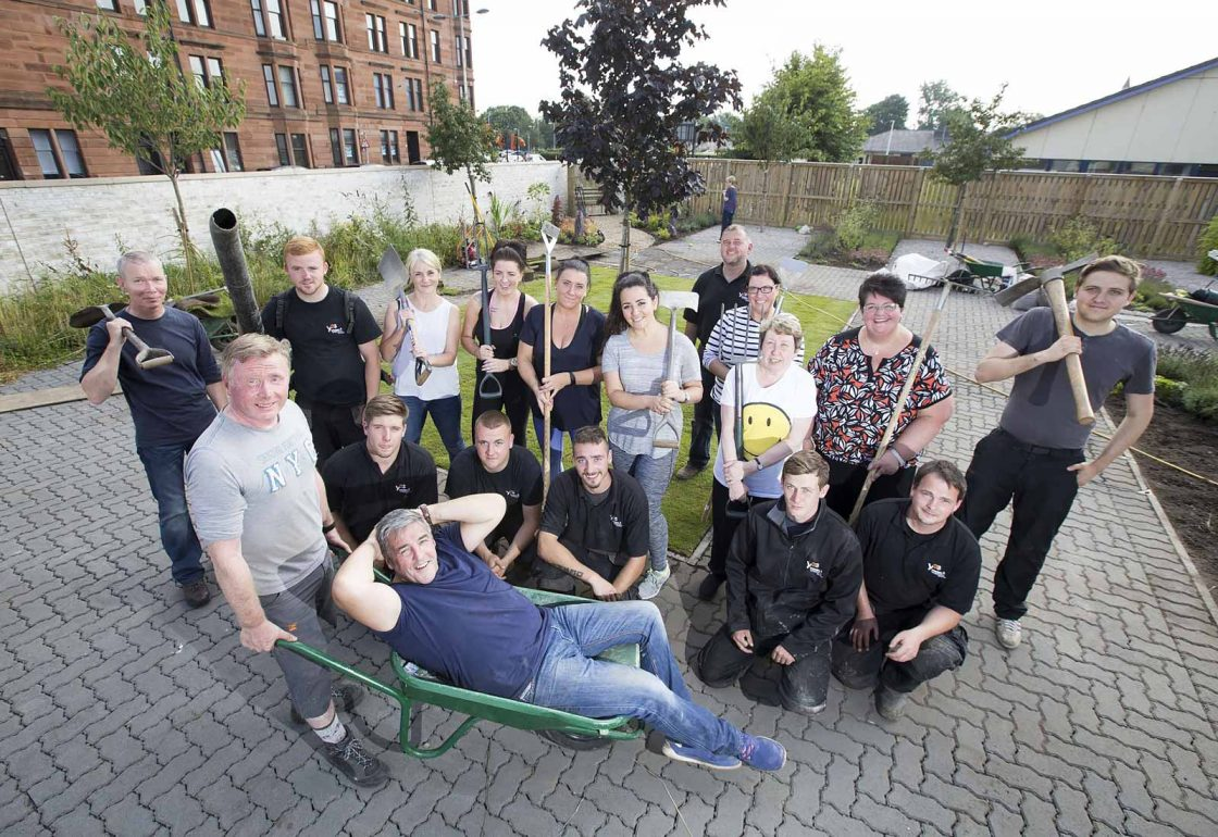 An image of a group of people of mixed ages helping with a gardening project representing Young Enterprise Scotland a grant by the Ellis Campbell Foundation helping disadvantaged young people in Hampshire, London and Perthshire