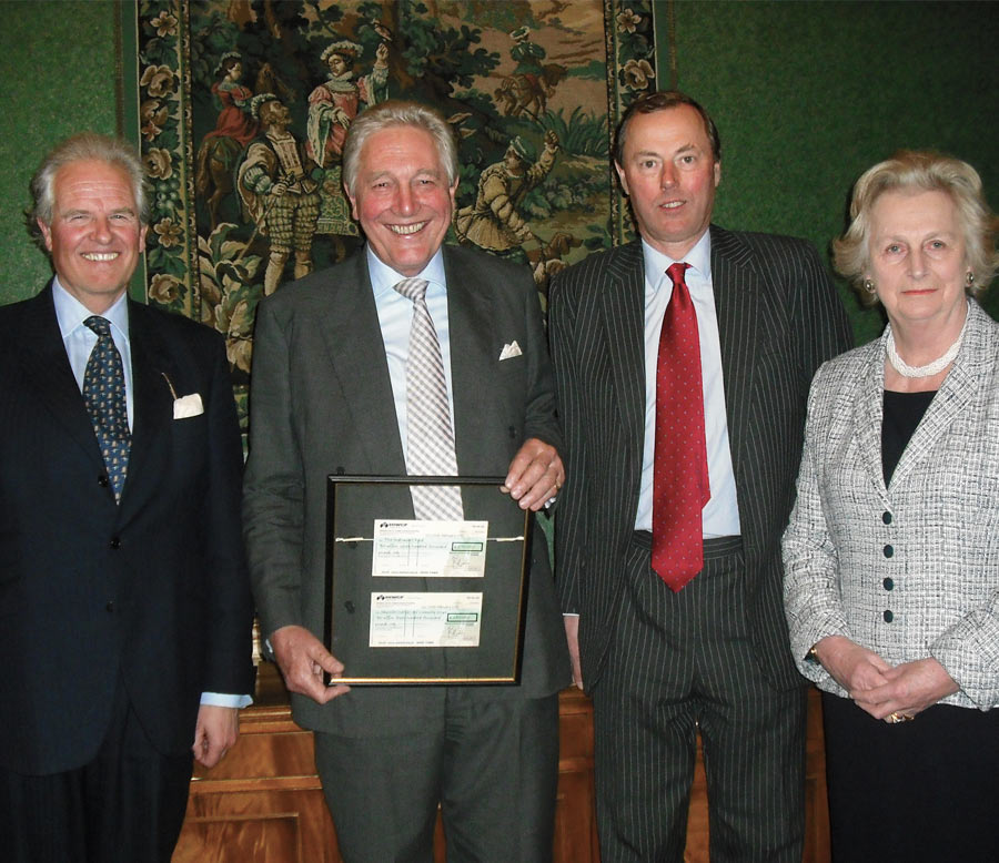 An image ofMichael Campbell receiving a thank you on his retirement from HIWCF