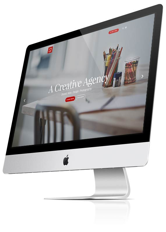 Picture of an iMac screen with the Crux Design Agency website on it. Crux is a digital agency based in Hampshire.
