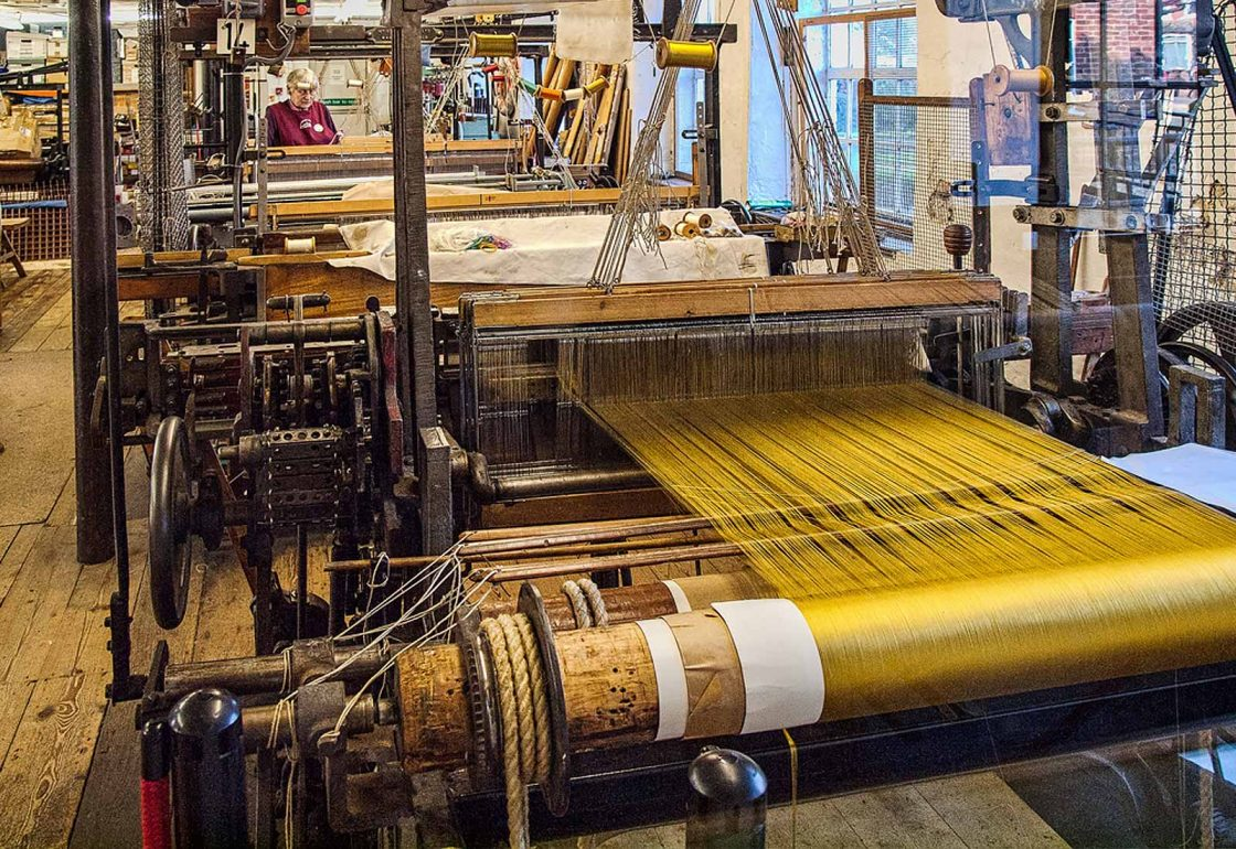 An image of a silk loom with yellow thread representing the Whitchurch Silk Mill Apprenticeship Grant made by the Ellis Campbell Foundation helping disadvantaged young people in Hampshire, London and Perthshire