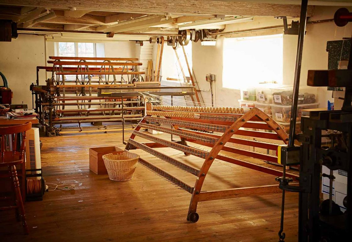 An image of an empty silk loom representing the Whitchurch Silk Mill Apprenticeship Grant made by the Ellis Campbell Foundation helping disadvantaged young people in Hampshire, London and Perthshire