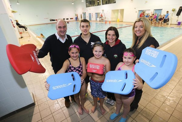 A colour image of children swimming and taking part in a Hope for Youth NI event, a charity supported by The Ellis Campbell Foundation