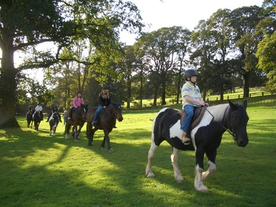 A colour image of a group of children on horseback taking part in theTeen Ranch youth Activity Centre supported by The Ellis Campbell Foundation