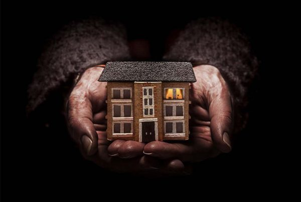 A colour image of hands holding a house used as the advert for Punchdrunk's Small Wonders production supported by The Ellis Campbell Foundation