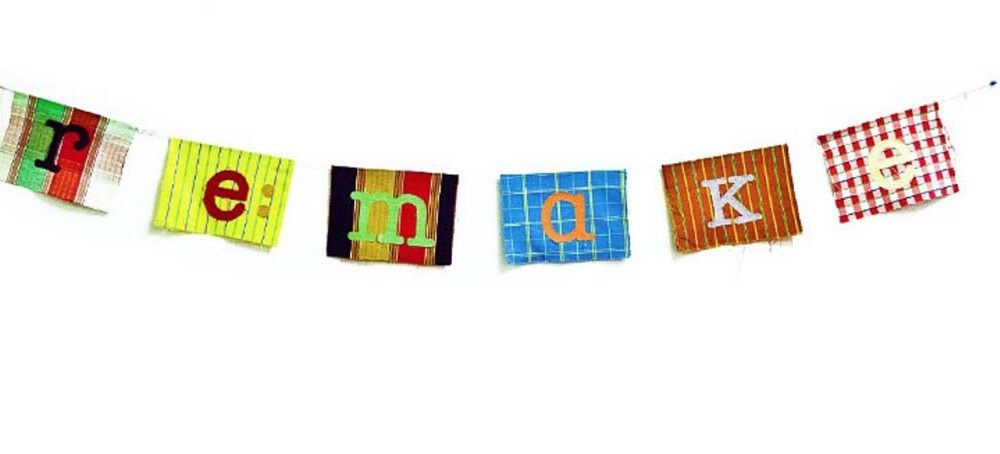 A colour image of a banner made of different materials spelling the word Remake used Remake Scotlands website a charity supported by the Ellis Campbell Foundation