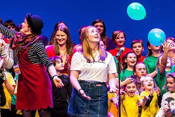 a bright colourful picture showing a group of children performing at the Horsecross Theatre - Perth Autism Youth Theatre supported by The Ellis Campbell Foundation